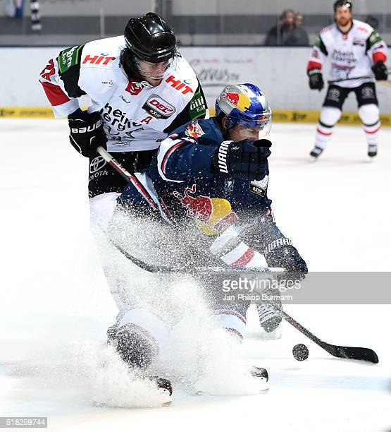 Ryan Jones of the Koelner Haien and Frank Mauer of EHC Red Bull Muenchen during the game between the EHC Red Bull Muenchen and Koelner Haie on March...