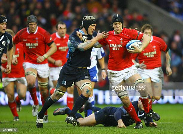 Ryan Jones of Wales holds off the challenge of Kelly Brown of Scotland during the RBS Six Nations match between Scotland and Wales at Murrayfield...