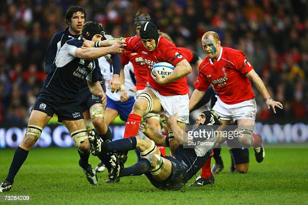 Ryan Jones of Wales is tackled by David Callam and Kelly Brown of Scotland during the RBS Six Nations match between Scotland and Wales at Murrayfield...