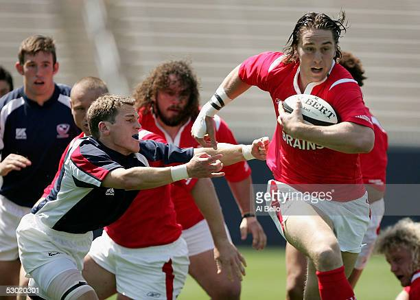 Ryan Jones of Wales runs with the ball as Doug Rowe of the USA attempts the tackle during their International test match on June 4 2005 at Rentschler...