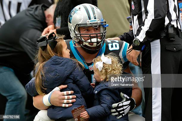 Ryan Kalil of the Carolina Panthers says hello to some young fans before the game against the Cleveland Browns at Bank of America Stadium on December...