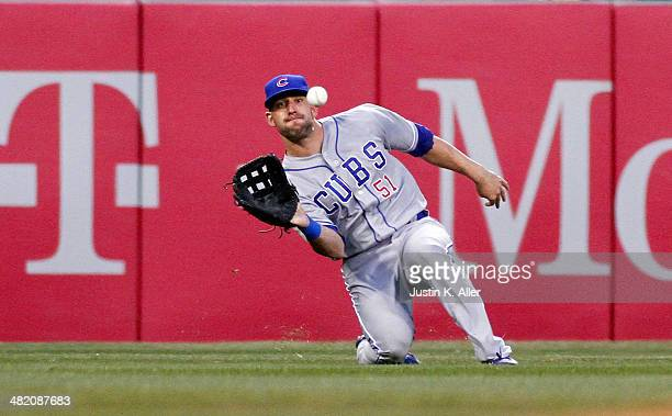 Ryan Kalish of the Chicago Cubs misplayed a ball on this play in the second inning against the Pittsburgh Pirates during the game at PNC Park April 2...