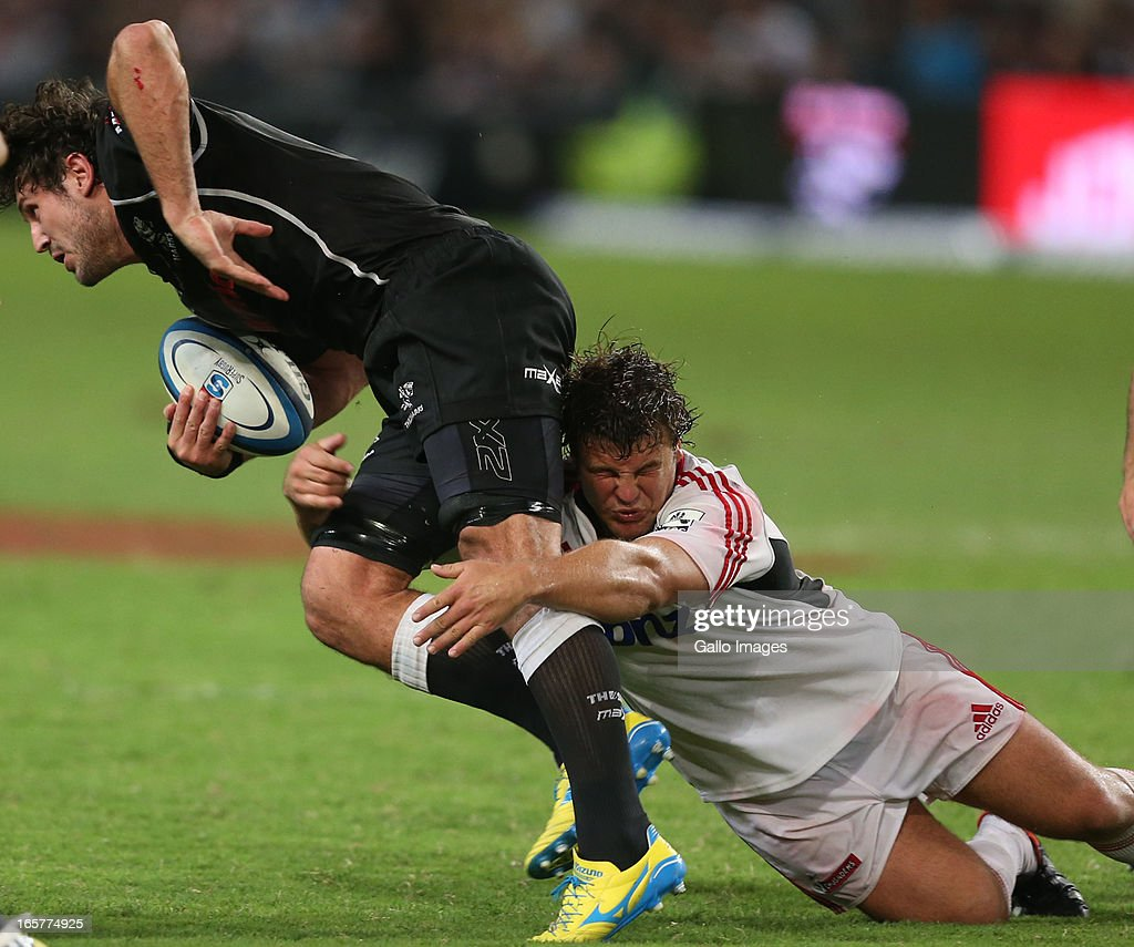 Ryan Kankowski is tackled by Ben Funnell during the Super Rugby match between The Sharks and Crusaders at Kings Park on April 05, 2013 in Durban, South Africa.