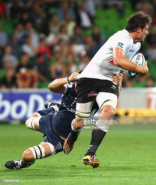 Ryan Kankowski of the Sharks is tackled during the round four Super Rugby match between the Melbourne Rebels and the Sharks at AAMI Park on March 11...
