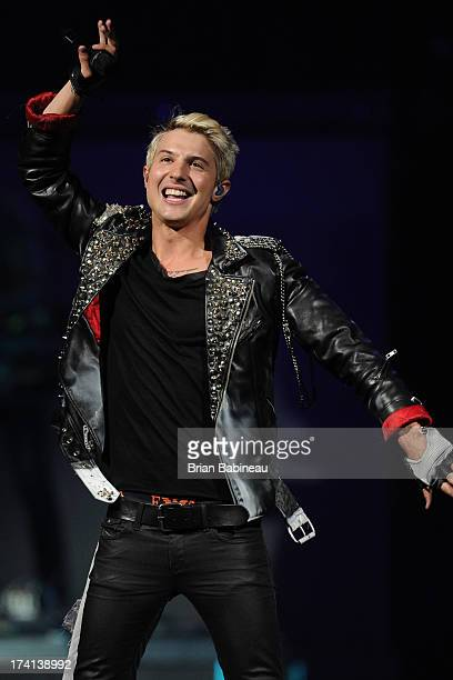 Ryan Keith Follese of Hot Chelle Rae performs at TD Banknorth Garden on July 20 2013 in Boston Massachusetts