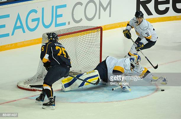 Ryan Keller and David Ullstrom fight for the puck during the IIHF Champions Hockey League match between Espoo Blues and HV71 Jonkoping on October 29,...