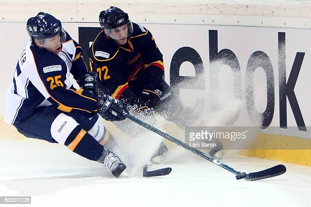 Ryan Keller of Espoo and David Jobin of Bern battle for the puck during the IIHF Champions Hockey League match between SC Bern and Espoo Blues at the...