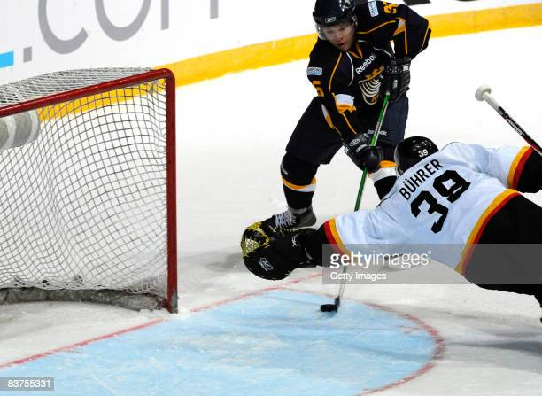 Ryan Keller of Espoo Blues fights for the puck during the IIHF Champions Hockey League match between Espoo Blues and SC Bern on November 19, 2008 in...
