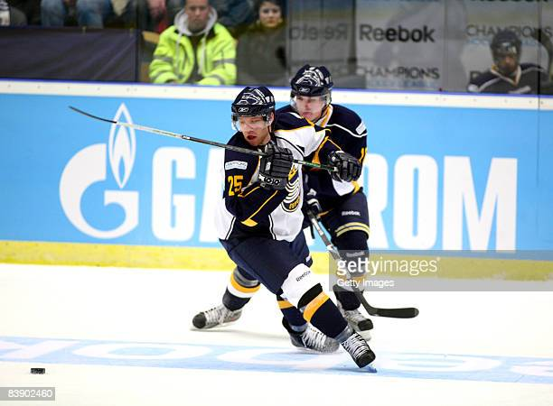 Ryan Keller of Espoo Blues fights for the puck during the IIHF Champions Hockey League match between HV 71 Joenkoeping and Espoo Blues on December 3,...