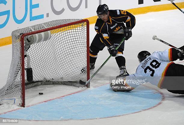 Ryan Keller of Espoo Blues scores a goal during the IIHF Champions Hockey League match between Espoo Blues and SC Bern on November 19, 2008 in Espoo,...