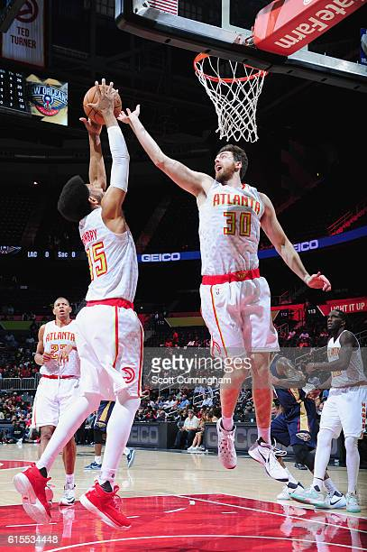 Ryan Kelly and DeAndre Bembry of the Atlanta Hawks jump for the rebound during a preseason game against the New Orleans Pelicans on October 18 2016...