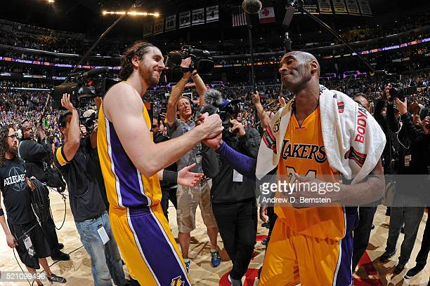 Ryan Kelly and Kobe Bryant of the Los Angeles Lakers hug after the game against the Utah Jazz on April 13, 2016 at Staples Center in Los Angeles,...