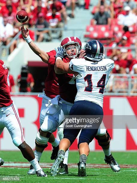 Ryan Kelly of the Alabama Crimson Tide blocks against Trey Hendrickson of the Florida Atlantc Owls on September 6 2014 at BryantDenny Stadium in...
