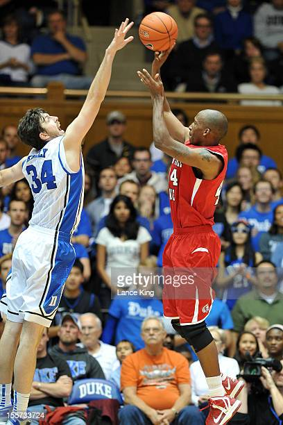 Ryan Kelly of the Duke Blue Devils blocks a shot by Wakefield Ellison of the WinstonSalem State Rams at Cameron Indoor Stadium on November 1 2012 in...