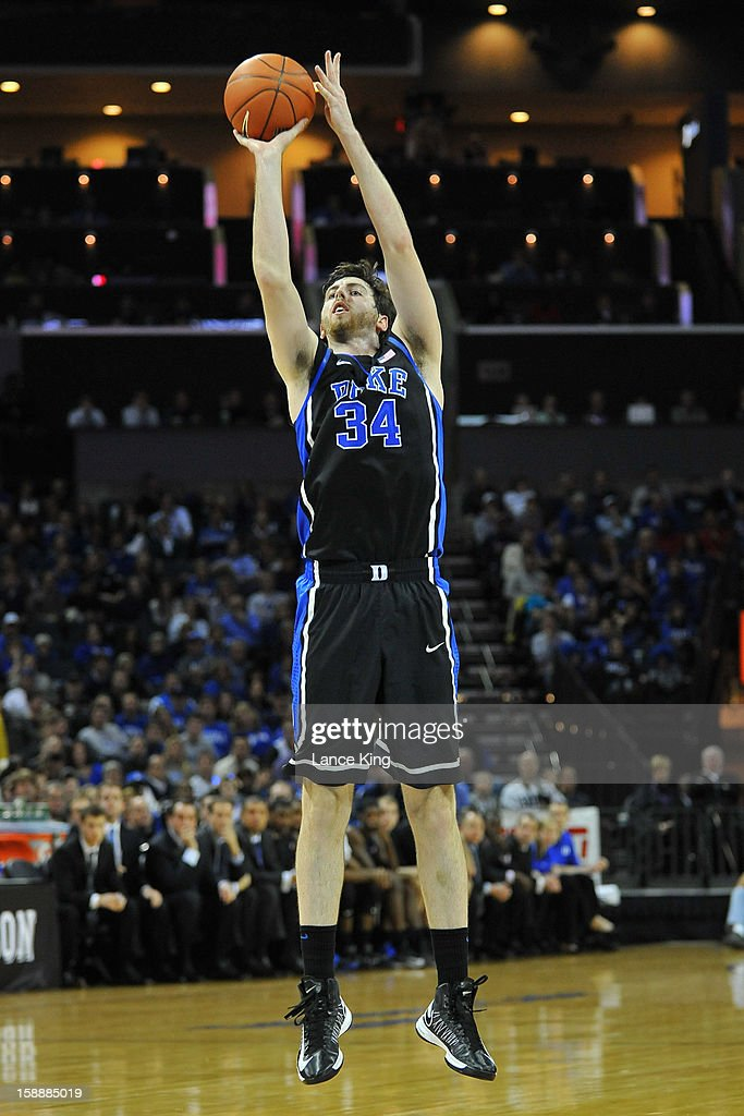 Ryan Kelly #34 of the Duke Blue Devils puts up a shot against the Davidson Wildcats at Time Warner Cable Arena on January 2, 2013 in Charlotte, North Carolina.