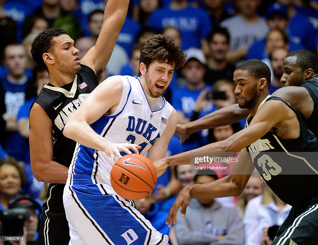 Ryan Kelly #34 of the Duke BlueDevils is defended by Devin Thomas #2, Aaron Roundtree #33 and Travis McKie #30 of the Wake Forest Demon Deacons during play at Cameron Indoor Stadium on January 5, 2013 in Durham, North Carolina.