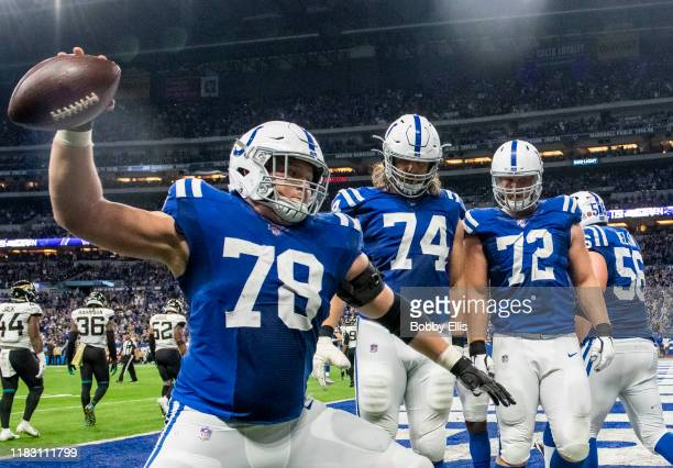 Ryan Kelly of the Indianapolis Colts spikes the ball after an Indianapolis Colts touchdown in the third quarter of the game against the Jacksonville...