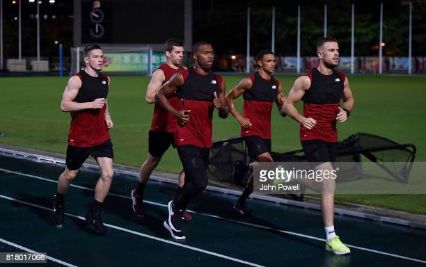 Ryan Kent Jon Flanagan Daniel Sturridge Jordan Henderson and Trent AlexanderArnold of Liverpool during a training session on July 18 2017 at the...