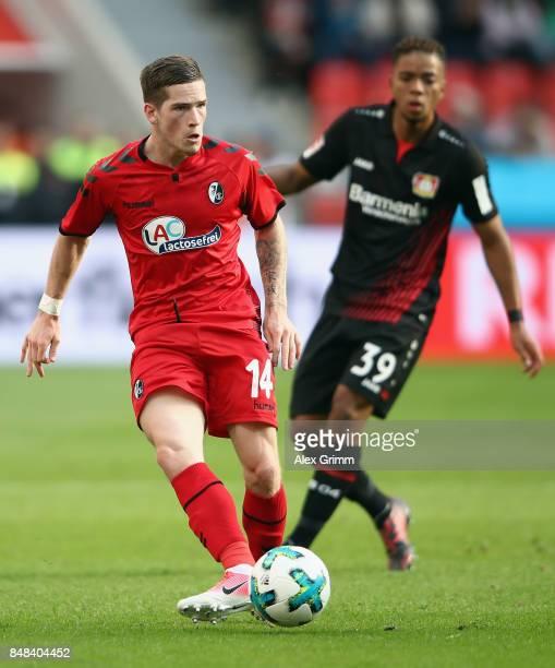 Ryan Kent of Freiburg is challenged by Benjamin Henrichs of Leverkusen during the Bundesliga match between Bayer 04 Leverkusen and SC Freiburg at...