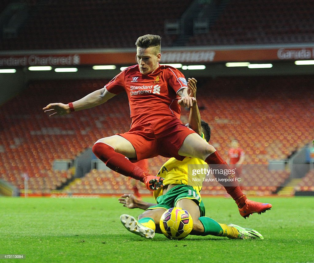 Ryan Kent of Liverpool and Jacob Murphy of Norwich City in action during the U21 Premier League match between Liverpool and Norwich City at Anfield on May 11, 2015 in Liverpool, England.