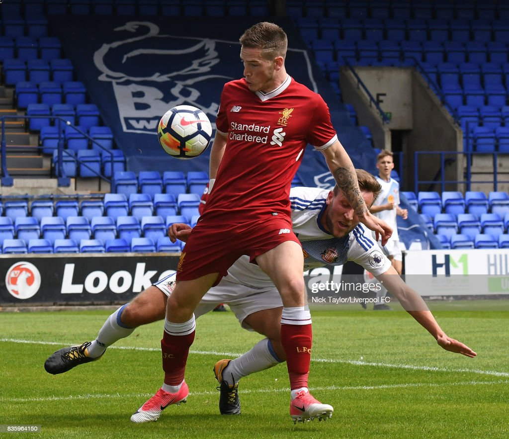 Ryan Kent of Liverpool and Joshua Robson of Sunderland in action during the Liverpool v Sunderland U23 Premier League game at Prenton Park on August 20, 2017 in Birkenhead, England.