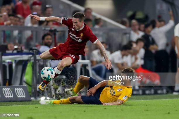 Ryan Kent of Liverpool and Sergi of Atletico Madrid battle for the ball during the Audi Cup 2017 match between Liverpool FC and Atletico Madrid at...
