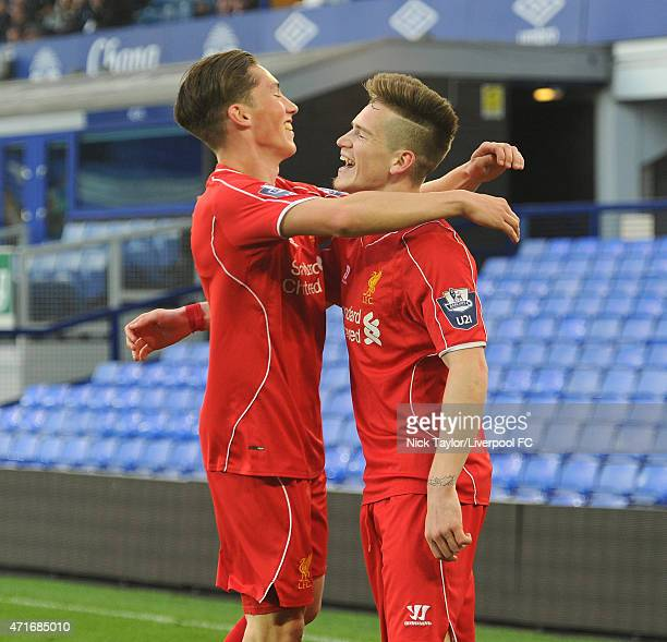 Ryan Kent of Liverpool celebrates scoring his first goal of the game with team mate Harry Wilson during the U21 Premier League match between Everton...