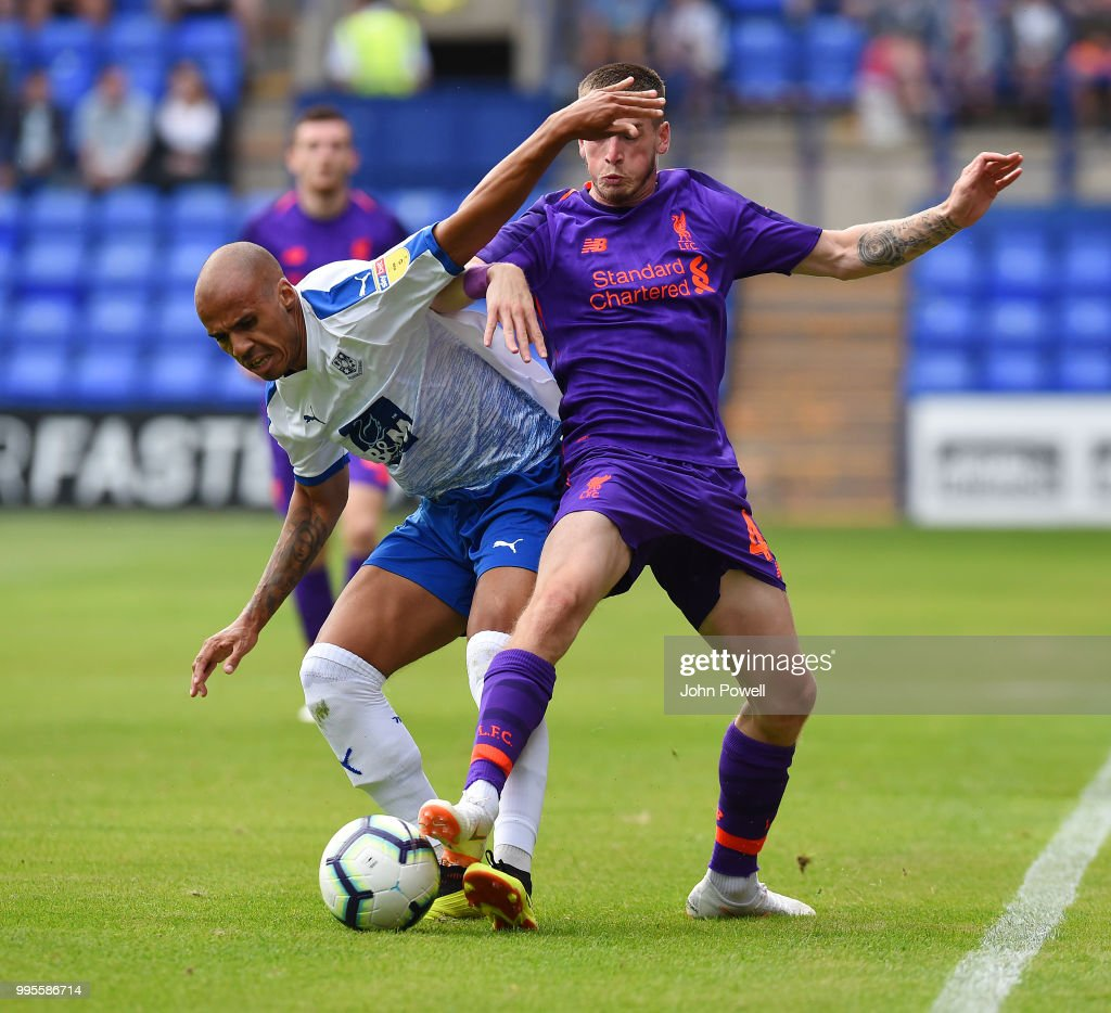 Ryan Kent of Liverpool competes with Jake Caprice of Tranmere Rovers during the pre-season friendly match between Tranmere Rovers and Liverpool at Prenton Park on July 10, 2018 in Birkenhead, England.