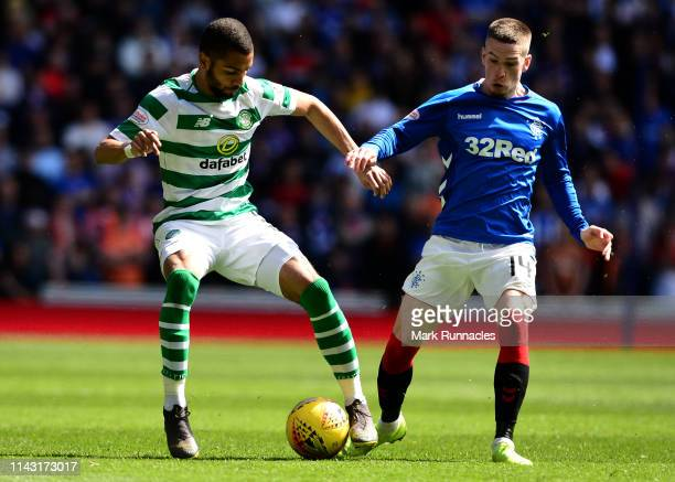 Ryan Kent of Rangers and Jeremy Toljan of Celtic challenge for the ball during the Ladbrokes Scottish Premiership match between Rangers and Celtic at...