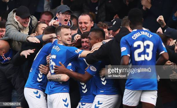 Ryan Kent of Rangers celebrates with team mates and supporters after he scores his team's opening goal during the Scottish Ladbrokes Premiership...