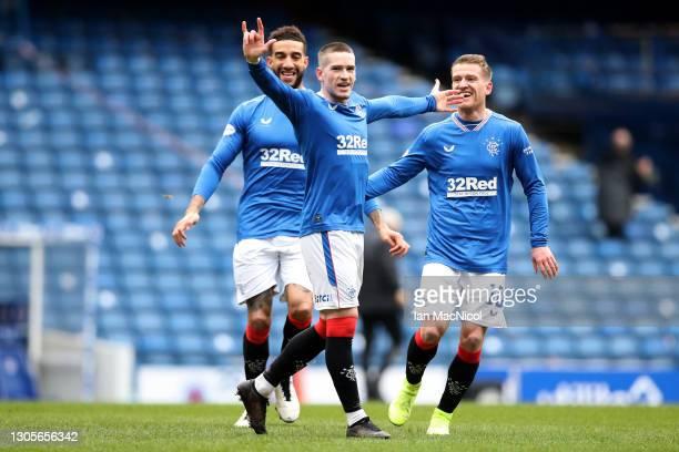 Ryan Kent of Rangers celebrates with teammate Steven Davis after scoring their team's first goal during the Ladbrokes Scottish Premiership match...