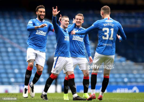 Ryan Kent of Rangers celebrates with teammates Connor Goldson, Steven Davis and Borna Barisic after scoring their team's first goal during the...