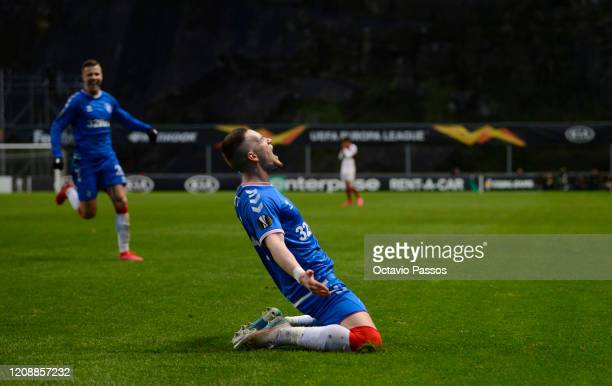 Ryan Kent of Rangers FC celebrates after scoring his team's first goal during the UEFA Europa League round of 32 second leg match between Sporting...