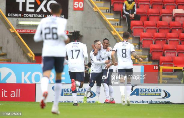 Ryan Kent of Rangers FC celebrates with Alfredo Morelos and team mates after scoring his team's first goal during the Ladbrokes Premiership match...