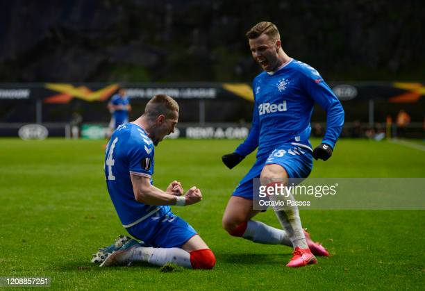 Ryan Kent of Rangers FC celebrates with Florian Kamberi after scoring his team's first goal during the UEFA Europa League round of 32 second leg...