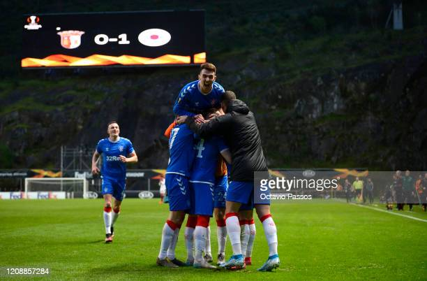 Ryan Kent of Rangers FC celebrates with teammates Scott Arfield Greg Stewart and Florian Kamberi after scoring his team's first goal during the UEFA...