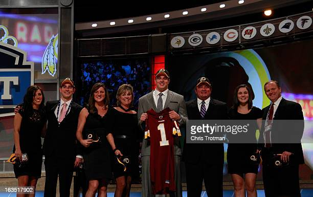Ryan Kerrigan, #16 overall pick by the Washington Redskins, poses with family on stage during the 2011 NFL Draft at Radio City Music Hall on April...