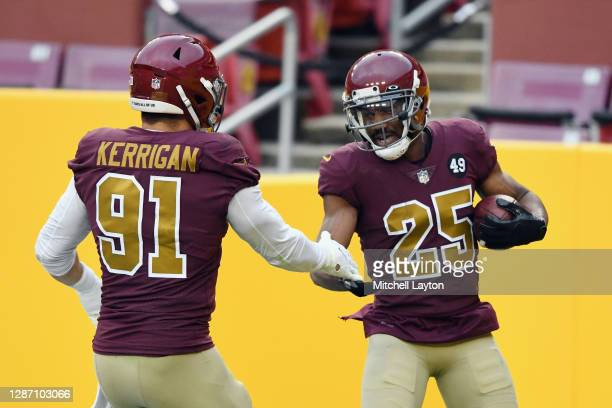 Ryan Kerrigan and Fabian Moreau of the Washington Football Team celebrate against the Cincinnati Bengals during the second half at FedExField on...