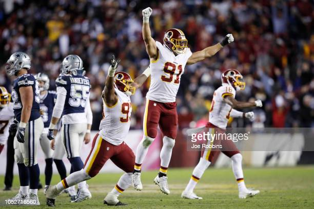 Ryan Kerrigan and Jonathan Allen of the Washington Redskins react after a missed field goal by the Dallas Cowboys as time expired in the game at...