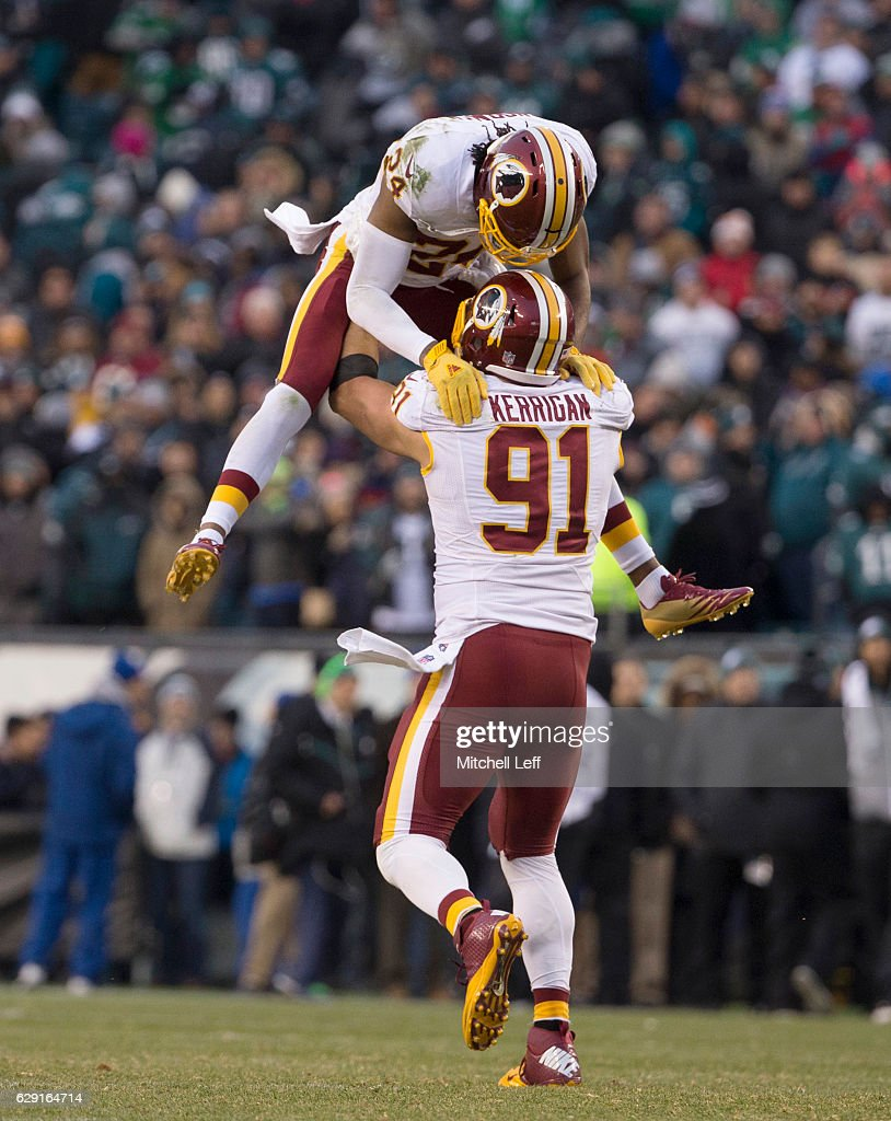 Ryan Kerrigan #91 and Josh Norman #24 of the Washington Redskins celebrate in the final moments of the game against the Philadelphia Eagles at Lincoln Financial Field on December 11, 2016 in Philadelphia, Pennsylvania. The Redskins defeated the Eagles 27-22.