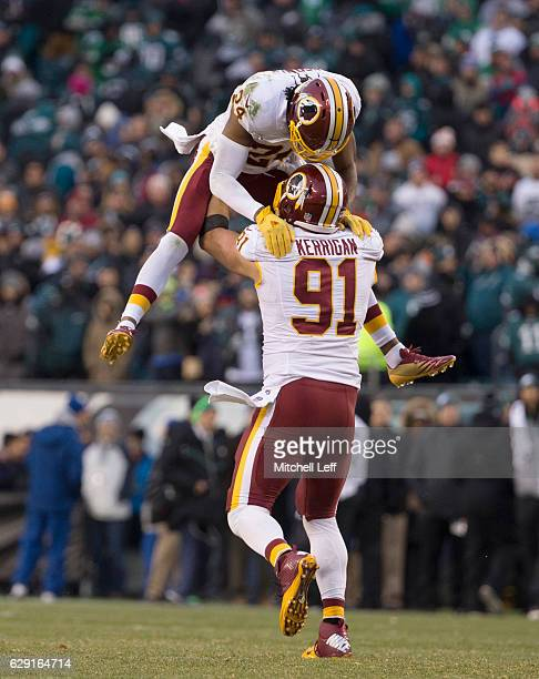 Ryan Kerrigan and Josh Norman of the Washington Redskins celebrate in the final moments of the game against the Philadelphia Eagles at Lincoln...