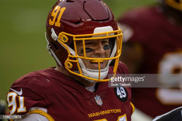 Ryan Kerrigan of the Washington Football Team celebrates after recording a sack against the Dallas Cowboys during the second half at FedExField on...