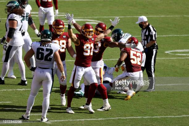 Ryan Kerrigan of the Washington Football Team celebrates after a play against the Philadelphia Eagles in the second half at FedExField on September...