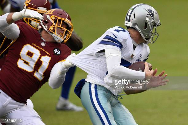 Ryan Kerrigan of the Washington Football Team sacks quarterback Ben DiNucci of the Dallas Cowboys in the fourth quarter of the game at FedExField on...