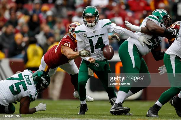 Ryan Kerrigan of the Washington Redskins causes Sam Darnold of the New York Jets to fumble during the first half at FedExField on November 17, 2019...