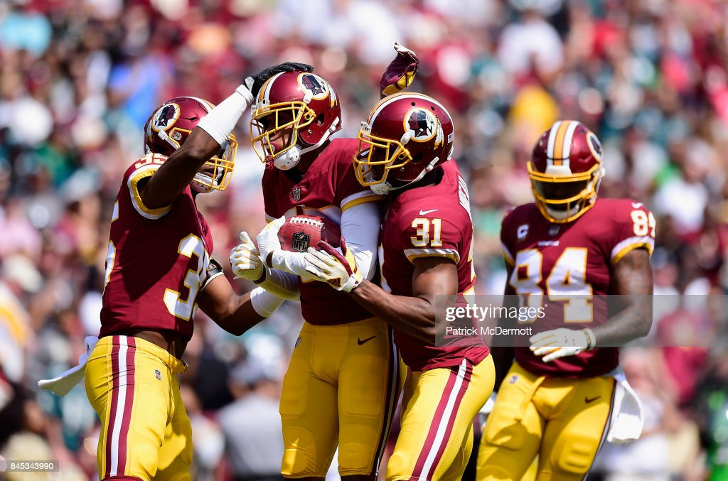 Ryan Kerrigan #91 of the Washington Redskins celebrates with teamates against the Philadelphia Eagles in the second quarter at FedExField on September 10, 2017 in Landover, Maryland.