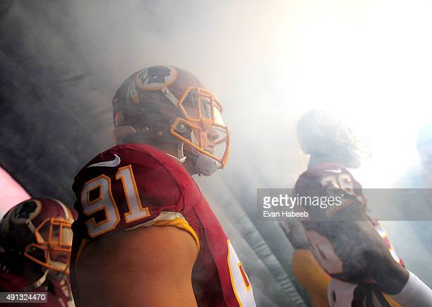 Ryan Kerrigan of the Washington Redskins gets introduced prior to the game against the Philadelphia Eagles at FedExField on October 4, 2015 in...
