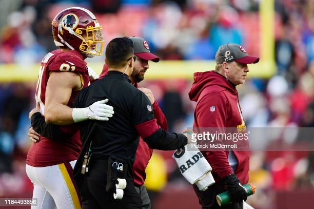 Ryan Kerrigan of the Washington Redskins is helped off the field in the second half against the Detroit Lions at FedExField on November 24, 2019 in...