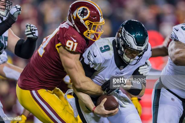 Ryan Kerrigan of the Washington Redskins sacks Nick Foles of the Philadelphia Eagles during the second half at FedExField on December 30, 2018 in...