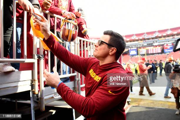 Ryan Kerrigan of the Washington Redskins signs autographs prior to the game against the Philadelphia Eagles at FedExField on December 15, 2019 in...